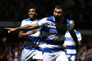 LONDON, ENGLAND - SEPTEMBER 21: Charlie Austin of Queens Park Rangers celebrates after scoring their sides first goal during the Carabao Cup Third Round match between Queens Park Rangers and Everton at Loftus Road on September 21, 2021 in London, England. (Photo by Ryan Pierse/Getty Images)