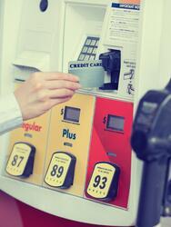 Woman,Hand,Swiping,Credit,Card,At,Gas,Pump,Station.