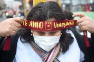 LIMA, PERU - SEPTEMBER 05: A fan of Venezuela adjusts a headband outside Estadio Nacional de Lima before a match between Peru and Venezuela as part of South American Qualifiers for Qatar 2022 on September 05, 2021 in Lima, Peru. (Photo by Ernesto Benavides - Pool/Getty Images)