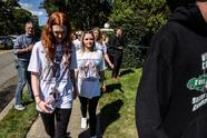 HOLBROOK, NY - SEPTEMBER 26: Mourners wearing t-shirts dedicated to Gabby Petito gather at a funeral home to pay respects to Gabby Petito on September 26, 2021 in Holbrook, New York. As the search continues into a second week in Florida to find Brian Laundrie, who is a person of interest, the family of Gabby Petito holds a public funeral in her hometown of Long Island. (Photo by Stephanie Keith/Getty Images)