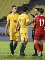 MALACCA, MALAYSIA - OCTOBER 05: Australian players talk to referee Alireza Faghani after the 2018 FIFA World Cup Asian Playoff match between Syria and the Australia Socceroos at Hang Jebat Stadium on October 5, 2017 in Malacca, Malaysia. (Photo by Robert Cianflone/Getty Images)
