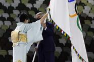 Governor of Tokyo Yuriko Koike gives the Olympic flag to International Olympic Committee's President Thomas Bach during the closing ceremony in the Olympic Stadium at the 2020 Summer Olympics, Sunday, Aug. 8, 2021, in Tokyo, Japan. (AP Photo/Jae C. Hong)
