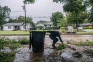 """HOUSTON, TEXAS - SEPTEMBER 14: Dallas Baines, 77, disposes of fallen tree branches after Tropical Storm Nicholas moved through the area on September 14, 2021 in Houston, Texas. """"I've got no power, so I thought I might as well get out and get some cleaning done. There hasn't been much flooding in this area since Harvey,"""" said Baines when asked about the Tropical Storm Nicholas. Nicholas strengthened to a Category 1 hurricane as it made landfall late Monday evening, but is gradually weakening as it moves towards the Northeast. Nicholas is projected to become a tropical depression by tomorrow. (Photo by Brandon Bell/Getty Images)"""
