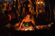 People celebrate the traditional Saint John night, which coincides with the summer solstice, with bonfires at the beach of Puerto de La Cruz, on the Spanish Canary island of Tenerife, on June 23, 2015. During the celebration, old clothes, papers and objects that represent bad memories are thrown into the flames. AFP PHOTO/ DESIREE MARTIN (Photo credit should read DESIREE MARTIN/AFP via Getty Images)