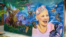"""""""Yo también sonrío con Gigi"""": crean mural en honor a Gigi Morél en Honduras la tierra de sus padres"""