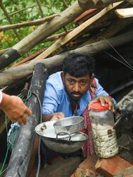 TOPSHOT - Villagers salvage items from their house damaged by cyclone Amphan in Midnapore, West Bengal, on May 21, 2020. - The strongest cyclone in decades slammed into Bangladesh and eastern India on May 20, sending water surging inland and leaving a trail of destruction as the death toll rose to at least nine. (Photo by Dibyangshu SARKAR / AFP) (Photo by DIBYANGSHU SARKAR/AFP via Getty Images)