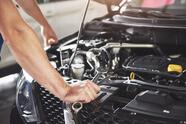 Close,Up,Hands,Of,Unrecognizable,Mechanic,Doing,Car,Service,And