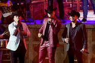 MIAMI, FLORIDA - FEBRUARY 18: (L-R) Ab Luna of Grupo Firme, Eduin Caz of Grupo Firme, and Lenin Ramírez perform onstage during Univision's 33rd Edition of Premio Lo Nuestro a la Música Latina at AmericanAirlines Arena on February 18, 2021 in Miami, Florida. (Photo by Rodrigo Varela/Getty Images for Univision)