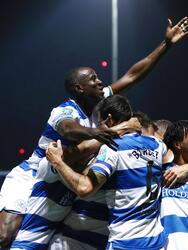 LONDON, ENGLAND - SEPTEMBER 21: Charlie Austin of Queens Park Rangers (obscured) celebrates with Albert Adomah after scoring their sides first goal during the Carabao Cup Third Round match between Queens Park Rangers and Everton at Loftus Road on September 21, 2021 in London, England. (Photo by Ryan Pierse/Getty Images)