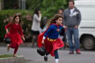 Girls fancy-dressed collect candies during the celebration of Halloween on October 31, 2013 in Santiago. Thousands of Chilean children took to the streets to ask for sweets to celebrate Halloween. AFP PHOTO/MARTIN BERNETTI (Photo credit should read MARTIN BERNETTI/AFP via Getty Images)