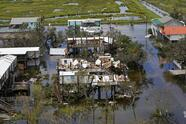 in this areal photo from a rescue flight provided by MedicCorps.org, destruction in Grand Isle, La. is seen in the aftermath of Hurricane Ida, Tuesday, Aug. 31, 2021. (AP Photo/Gerald Herbert)