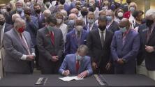 Gobernador de Georgia, Brian Kemp firma la ley contra crímenes de odio