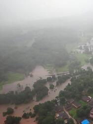 This photograph provided by Indian Air Force shows flooding in Ratnagiri district, in the western Indian state of Maharashtra, Thursday, July 22, 2021. Landslides triggered by heavy monsoon rains hit parts of western India, killing at least five people and leading to the overnight rescue of more than 1,000 other people trapped by floodwaters, an official said Friday. (Indian Air Force via AP)