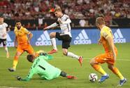 Adeyemi pone el sexto de Alemania en tiempo de compensación