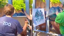 Hipopótamos se divierten mientras pintan con colores