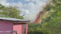 Logran sofocar incendio que amenazaba zona residencia en Vega Baja