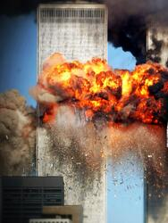 NEW YORk - SEPTEMBER 11, 2001: (SEPTEMBER 11 RETROSPECTIVE) A fiery blasts rocks the south tower of the World Trade Center as the hijacked United Airlines Flight 175 from Boston crashes into the building September 11, 2001 in New York City. (Photo by Spencer Platt/Getty Images)