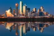 Dallas skyline at sunset reflected in the flooded Trinity River
