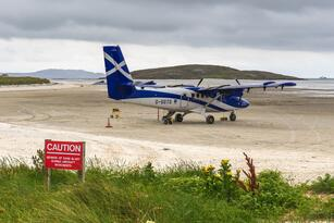 [Isle of Barra, Scotland - Aug 2019] Small plane on the sandy runway of Barra Airport, Scotland - High quality photo