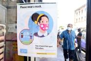 A storefront sign reminds people to wear a facemask on July 19, 2021 in Los Angeles, California. - A continuing resurgence in the Covid-19 pandemic is seeing local rates rise and hospitalizations skyrocket amid a new face-covering mandate that went into effect over the weekend. (Photo by Frederic J. BROWN / AFP) (Photo by FREDERIC J. BROWN/AFP via Getty Images)