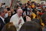 Pope Francis (3rd-L) is greeted by people as he arrives at the Syriac Catholic Church of the Immaculate Conception (al-Tahira-l-Kubra), in the predominantly Christian town of Qaraqosh (Baghdeda), in Nineveh province, some 30 kilometres from Iraq's northern Mosul on March 7, 2021, while accompanied by Syriac Catholic Archbishop of Mosul Youhanna Boutros Moshe (2nd-L). (Photo by Vincenzo PINTO / AFP) (Photo by VINCENZO PINTO/AFP via Getty Images)
