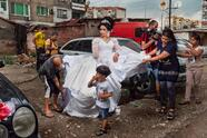1st classified Zor by Selene Magnolia A young bride is preparing for her wedding on a street in the Roma ghetto of Stolipinovo. In Europe, Roma communities number more than 11 million people and Stolipinovo, with around 40,000 people, is the most populous ghetto.
