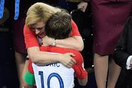 TOPSHOT - Croatian President Kolinda Grabar-Kitarovic (rear C) comforts Croatia's midfielder Luka Modric (front C) during the trophy ceremony at the end of the Russia 2018 World Cup final football match between France and Croatia at the Luzhniki Stadium in Moscow on July 15, 2018. (Photo by GABRIEL BOUYS / AFP) / RESTRICTED TO EDITORIAL USE - NO MOBILE PUSH ALERTS/DOWNLOADS (Photo credit should read GABRIEL BOUYS/AFP/Getty Images)