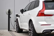 A Volvo XC60 hybrid car is seen plugged into a charging point outside a Volvo dealership in Reading, west of London, on March 2, 2021. - Chinese-owned Swedish automaker Volvo said on March 2 it will produce only electric vehicles by 2030 and sell them all exclusively online. (Photo by Ben STANSALL / AFP) (Photo by BEN STANSALL/AFP via Getty Images)
