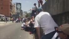 Con disparos y bombas lacrimógenas reprimen manifestación de la oposición en Venezuela