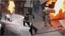 Bombero carga un tanque envuelto en llamas para impedir una tragedia