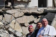 """TOPSHOT - Pope Francis (R), accompanied by the Chaldean Catholic Archbishop of Mosul Najib Michaeel Moussa (L), looks on at a square near the ruins of the Syriac Catholic Church of the Immaculate Conception (al-Tahira-l-Kubra), in the old city of Iraq's northern Mosul on March 7, 2021. - Pope Francis, on his historic Iraq tour, visits today Christian communities that endured the brutality of the Islamic State group until the jihadists' """"caliphate"""" was defeated three years ago (Photo by Vincenzo PINTO / AFP) (Photo by VINCENZO PINTO/AFP via Getty Images)"""