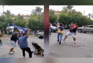 (VIDEO) Con un bebé en sus brazos, hincha pelea en la previa de un partido de fútbol