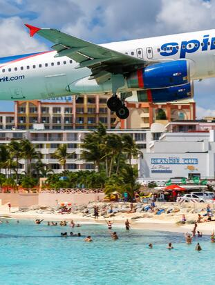 Sint Maarten – September 17, 2016: Spirit Airlines Airbus A320 airplane at Sint Maarten airport (SXM) in Sint Maarten. Airbus is a European aircraft manufacturer based in Toulouse, France.