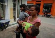Dos meses caminando con dos niños a cuestas: la historia de una familia que huye de Honduras en la caravana