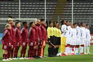LIMA, PERU - SEPTEMBER 05: Players of Venezuela and Peru line up before a match between Peru and Venezuela as part of South American Qualifiers for Qatar 2022 at Estadio Nacional de Lima on September 05, 2021 in Lima, Peru. (Photo by Ernesto Benavides - Pool/Getty Images)