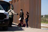Migrants from Columbia wait to be processed after turning themselves over to authorities at the United States and Mexico border May 12, 2021 in Yuma, Arizona. - Apprehensions of undocumented immigrants at the US border with Mexico rose to a fresh 15-year high in April as the Biden administration failed to deter migrants, official data showed on May 11. US Customs and Border Protection reported it had interdicted 178,622 people trying to enter the United States without official immigration papers last month, up more than 5,000 from March's high numbers. (Photo by RINGO CHIU / AFP) (Photo by RINGO CHIU/AFP via Getty Images)