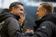 DORTMUND, GERMANY - JANUARY 26: Sports director Michael Zorc of Dortmund and Manager Horst Heldt of Hannover prior the Bundesliga match between Borussia Dortmund and Hannover 96 at the Signal Iduna Park on January 26, 2019 in Dortmund, Germany. (Photo by Jörg Schüler/Getty Images)