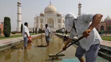 De blanco a amarillo y verde: el triste motivo por el cual el Taj Mahal está cambiando de color
