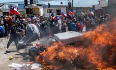 Crisis en Chile: ¿qué hay detrás de la quema del campamento de migrantes venezolanos?