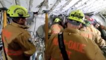 Un túnel bajo los escombros: las operaciones de rescate en el edificio colapsado al norte de Miami Beach