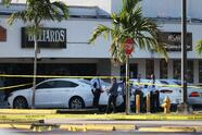 HIALEAH, FLORIDA - MAY 30: Miami-Dade police investigate near shell case evidence markers on the ground where a mass shooting took place outside of a banquet hall on May 30, 2021 in Hialeah, Florida. Police say that two people died, and an estimated 20 to 25 people were injured after the shooting early on Sunday, May 30 at a banquet hall, which was rented out for a concert. (Photo by Joe Raedle/Getty Images)